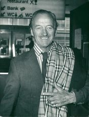 David Niven on London Heathrow on his way to the United States