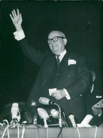 Georges Bidault speaks at a press conference