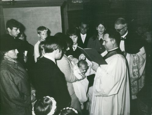 Wolfgang Speicher in a baptismal.