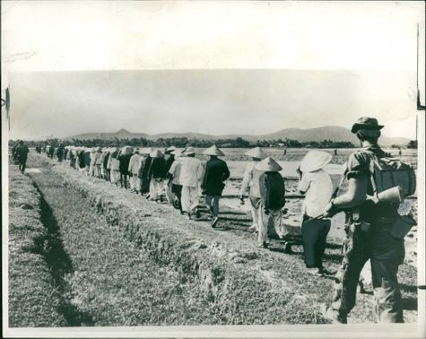 Peasants being marched out of a village during Vietnam War