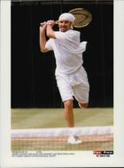 Andre Agassi participates in the Wimbledon Tournament.