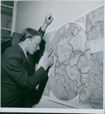 A man studying a war map during WWII in Sweden, 1940.