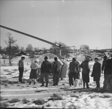 Helicopter party premiere, at the airfield, people watching in snow