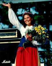 Crown Princess Victoria waves smoothly with her fellow full of flowers on her 18th birthday