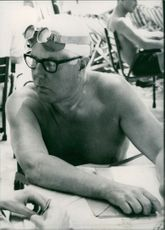 Close-Up of a man wearing goggles and a swim cap.