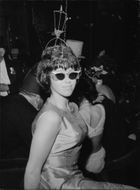 Dressed lady with headdress at the Opera Masquerade