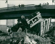 road accidents:a container lorry lying upside down after going through the crash.