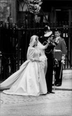 Prince Andrew and Sarah Ferguson wave to the guests outside Westminster Abbey after the wedding has taken place.