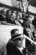 Princess Anne and prince Charles sitting among spectators.