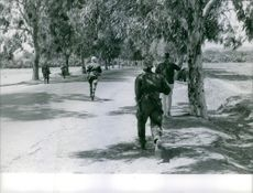 Soldiers running on the road during an operation in Bizerte  1961