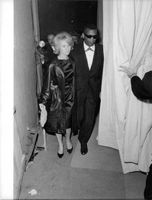 Ray Charles Robinson walking along with a woman.