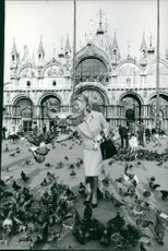 Michelle Morgan feeding the pigeons.