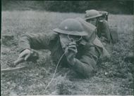 1942 Royal engineers demonstration. A Royal Engineer using an electric mine-detector during the demonstration. 1942
