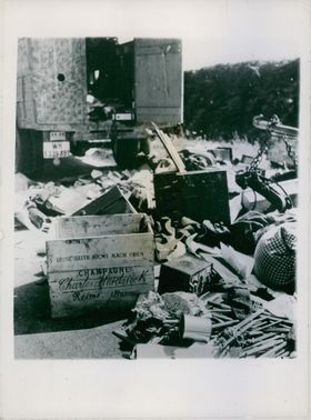 The loot scattered in the street. 1944.
