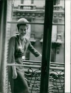 Princess Maria Gabriella standing in balcony and smiling.