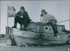 Soldiers in the boat with a Sweden flag in Sweden during World War II, 1944.