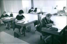 People working in office, writing.  1963