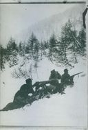 Austrian soldiers aim their weapons for a fight. 1916.