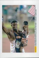 Allen Johnson with his daughter after the gain of 110m hedge during the Olympic Games in Atlanta in 1996
