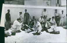 Allies free Italian political prisoners during World War II, they waiting with their baggage