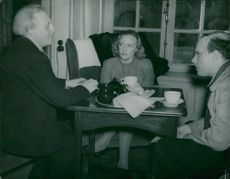 Pär Lagerkvist with Mr. and Mrs Olof Widgren during a lunch break at Dramaten