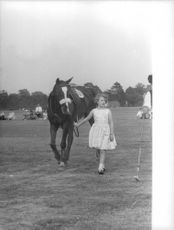Princess Anne standing with horse.
