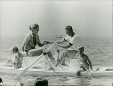 Prince Albert II with family sailing on  a boat.