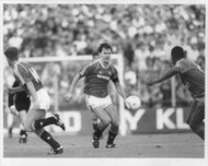 Bryan Robson in action for Manchester United