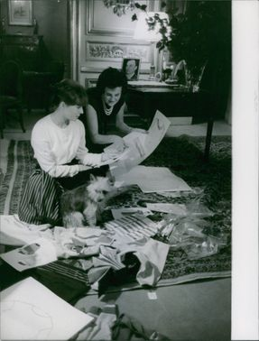 Bettina is checking the design of her clothes. October 25, 1960