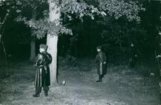 Three guards standing on the forest on night shift.