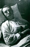Jean-David Levitte was laying on the bed in the hospital.