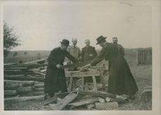 1915 Polish priests has help with rought jobs like sawing of wood during the war due to lack of manpower.