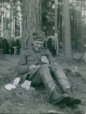 Soldier taking a rest and is happily reading his letters