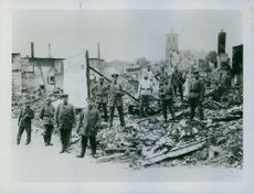 The War: The Germans in Belgium. Some German officers viewing the work of their heavy guns.