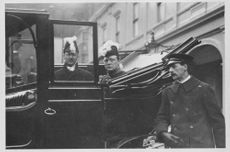 Winston Churchill in vehicle.