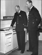 Inspector Gunnar Hjårling and Officer Carl-Åke Rahm in the new police station's kitchen