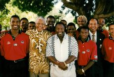 Nelson Mandela together with South African football players and their coaches.