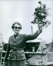 Mrs. Josephine Williams Goldwater waving a bouquet in triumph.