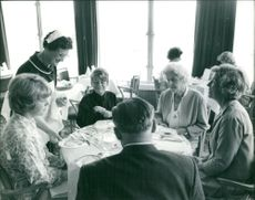 Bob Manry's family, friend and doctor dining together in the hotel before his arrival.