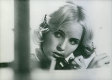 Marie-France Boyer talking on the telephone. 1965.