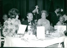 Sheila, Robert Favre Le Bret, and Begum Aga Khan III gathered together in a party.