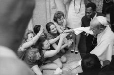 Pope Paul VI meeting with people.