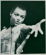 Eartha Kitt is expressive on stage in beautiful light dress