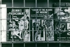 Posters behind the bars.