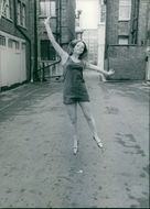A lady being photographed on her jumping stance.