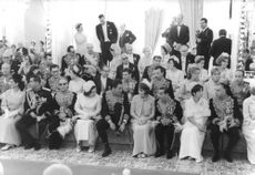 People at a ceremony, a vintage photo from the King Jean D folder in an old press archive.