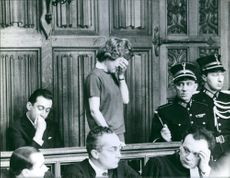 Suzanne Vandeput seen crying at the court during their trial in Liège, Belgium. 1962.
