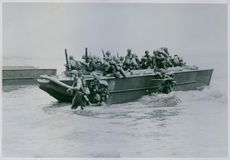 soldiers on the military boat in the sea during Nigerian War.