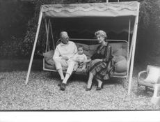 Brigitte Bardot son sitting with his grandparents.