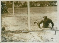 Goalkeeper wasn't able to stop the ball from reaching the goal during the 1927 International Match between Sweden and Belgium players held in Brussels.